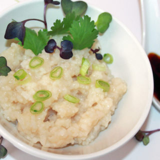Quick Congee Recipe - A bowl of congee with fresh herbs and a sprinkle of chopped green onions freshisreal.com