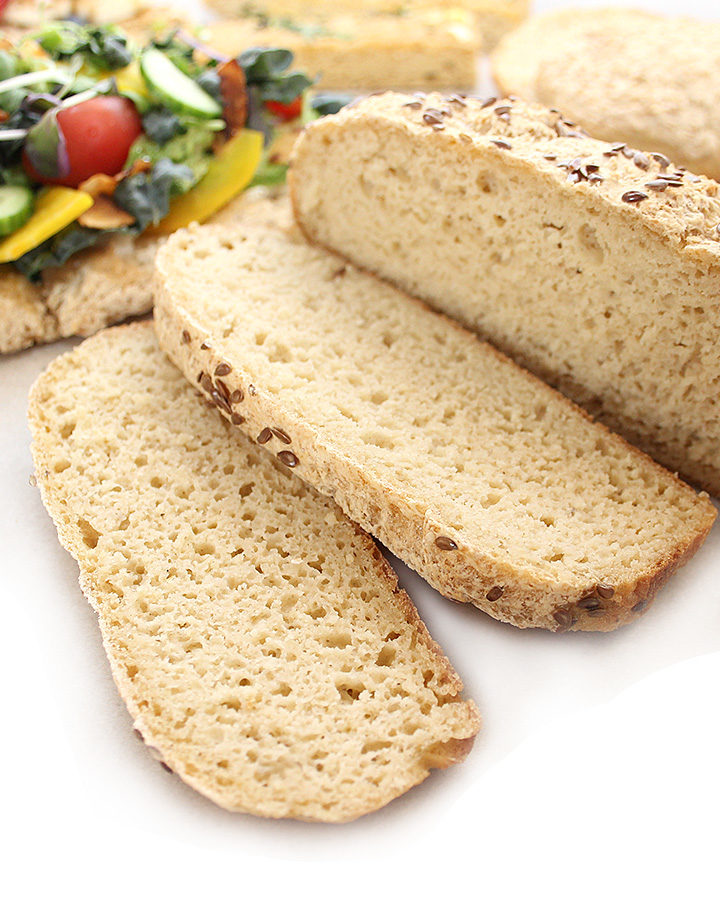 A picture of a yeasted, gluten-free, and vegan sliced loaf of bread. Free of all top allergens. freshisreal.com