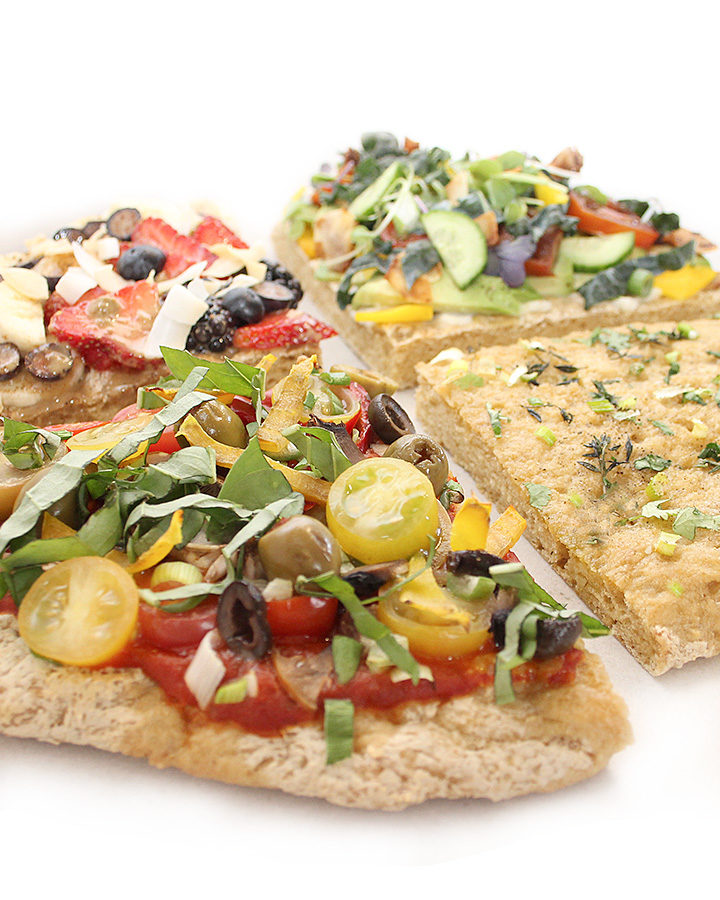 A picture of a yeasted, gluten-free, and vegan pizza topped with plant-based ingredients. Free of all top allergens. freshisreal.com