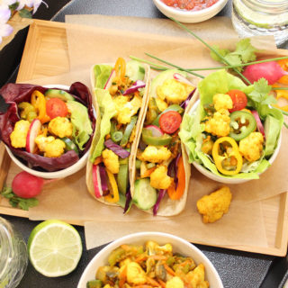 Vegetable Taco Filling prepared with cauliflower, celery, carrots, zucchini, onions, and cilantro as a base. Served in gluten-free brown rice wraps and lettuce cups. Gluten-Free   Vegan   freshisreal.com