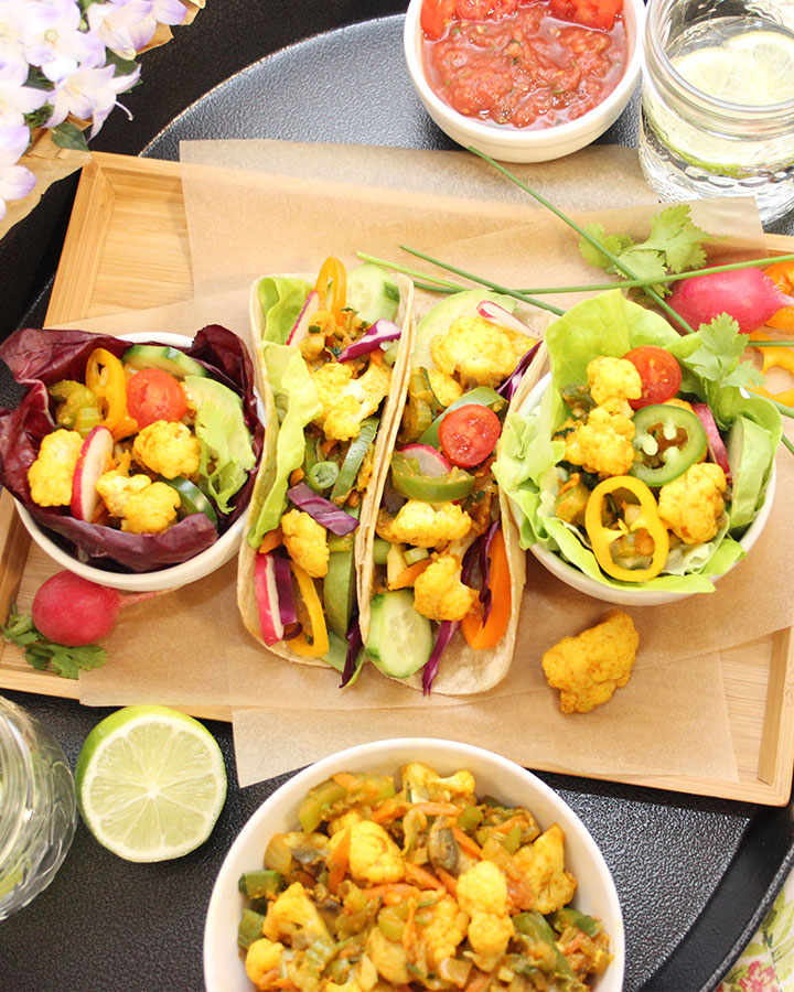 Vegetable Taco Filling prepared with cauliflower, celery, carrots, zucchini, onions, and cilantro as a base. Served in gluten-free brown rice wraps and lettuce cups. Gluten-Free | Vegan | freshisreal.com