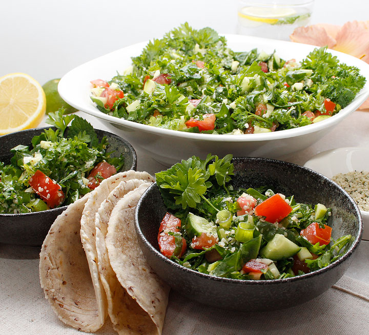 Combine fresh garden vegetables and herbs like parsley, mint, cucumbers, zucchini, tomatoes, and greens with a simple lemon and olive oil dressing to create the most delicious salad! Find the recipe at freshisreal.com