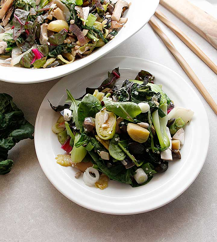 A delicious Warm Winter Salad prepared with fresh greens, bok choy and mushrooms that can be ready in less than 40 minutes! Visit freshisreal.com for the recipe!