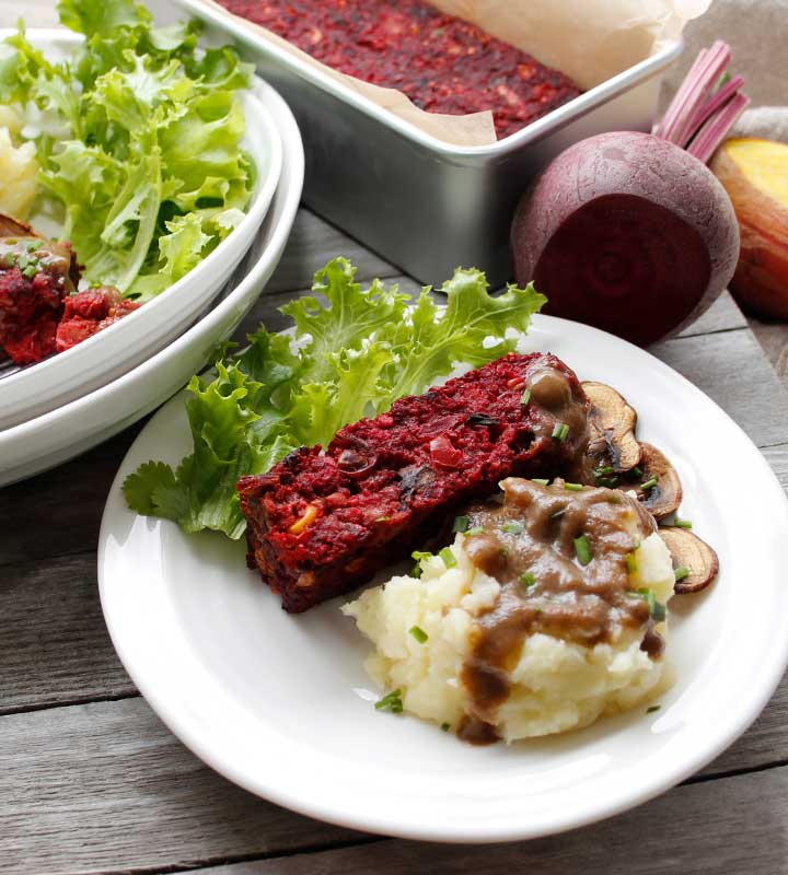 A beautifully coloured gluten-free vegan vegetable loaf, filled with an abundance of fresh produce like beets, potatoes, carrots, mushrooms, peas, corn, red pepper, herbs with a few additional ingredients. Delicious served with homemade gravy, potatoes and a side of greens! freshisreal.com
