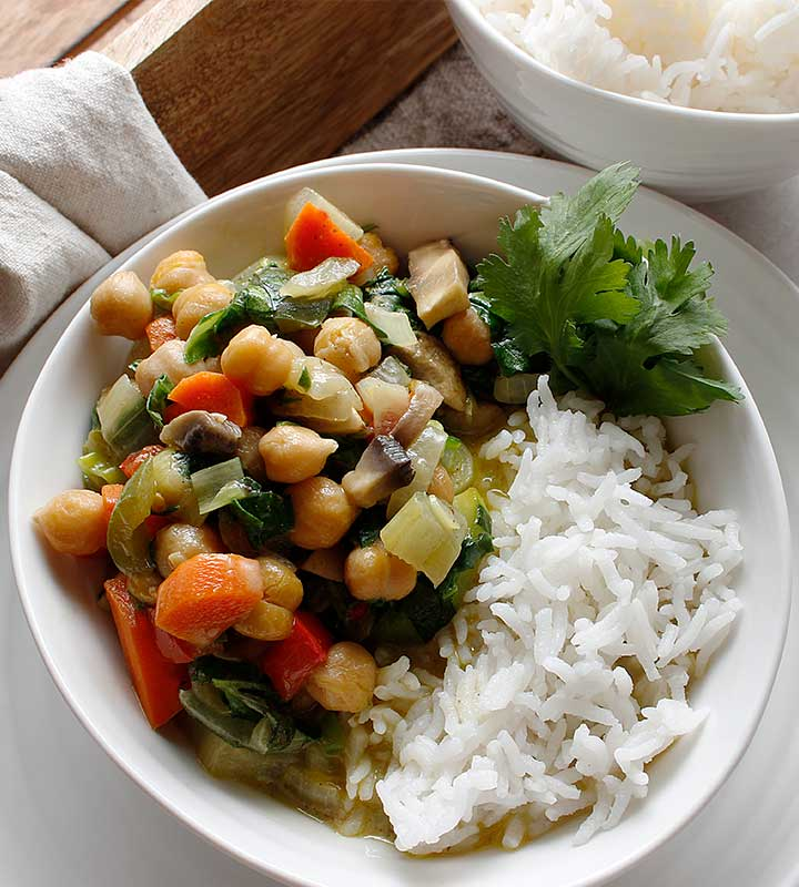 A colourful plant-based Vegetable Chickpea Stew packed with nutritious ingredients, including organic chickpeas. freshisreal.com