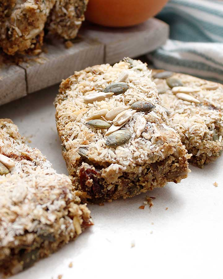 Grain-Free Pumpkin Bars prepared with raw sunflower and pumpkin seeds, tiger nut flour and organic pumpkin purée with a few additional allergen-friendly ingredients.