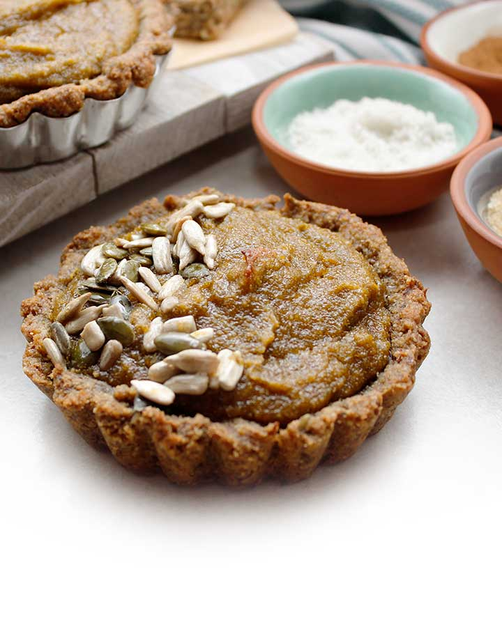 Grain-Free Pumpkin Tarts prepared with raw sunflower and pumpkin seeds, tiger nut flour and organic pumpkin purée with a few additional allergen-friendly ingredients.