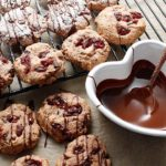 Gluten-free, vegan shortbread cookies with a raspberry twist! Once baked, the cookies are dusted with organic powdered sugar and drizzled with chocolate. These cookies are also grain-free and allergen-friendly.