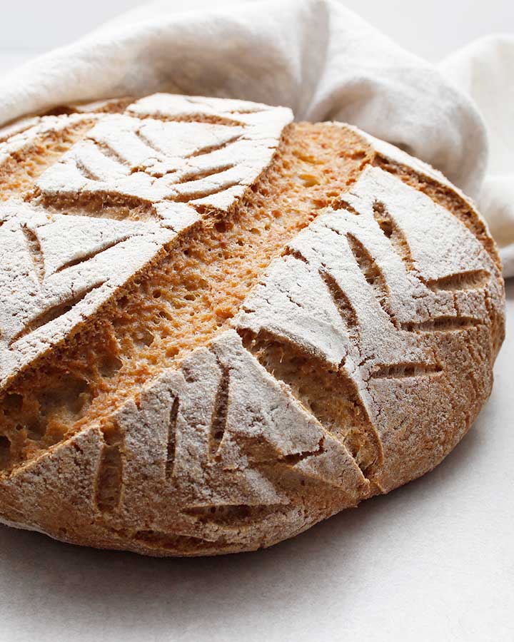 A beautiful crusty artisan-style, free-form, gluten-free and vegan Buckwheat Sourdough Loaf. Allergen-Friendly. freshisreal.com