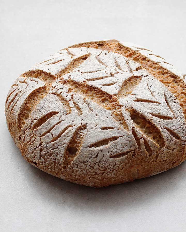 A beautiful crusty artisan-style, free-form, gluten-free and vegan Buckwheat Sourdough Loaf. Allergen-Friendly. freshisreal.com