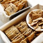 Homemade seed crackers in two small baskets.