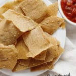 Thin and crispy gluten-free sourdough discard crackers with a side of salsa.