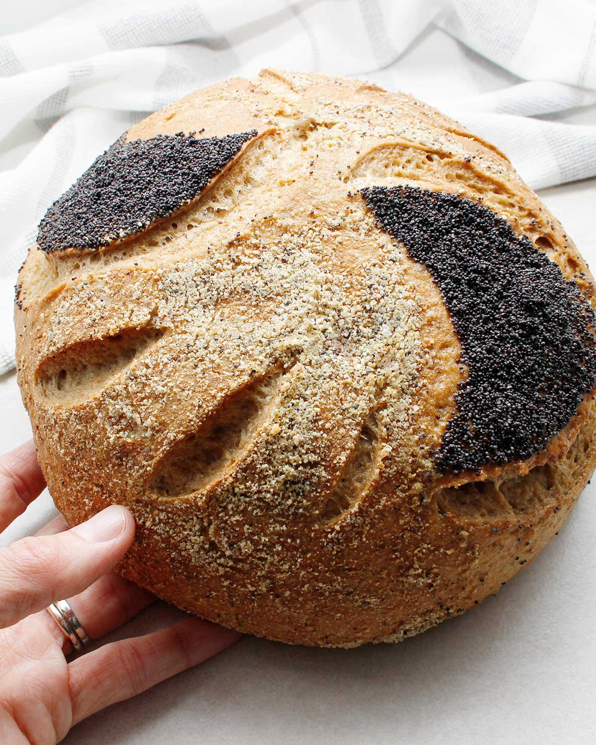 Wild yeast bread boule decorated with poppy seeds