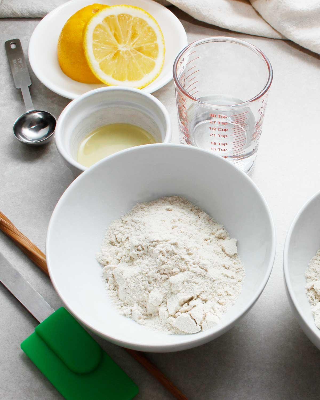 Ingredients to make gluten-free sourdough starter: brown rice flour, water and lemon juice.