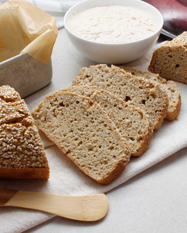 Simple 4-ingredient BBQ baked sliced gluten-free sourdough loaf.