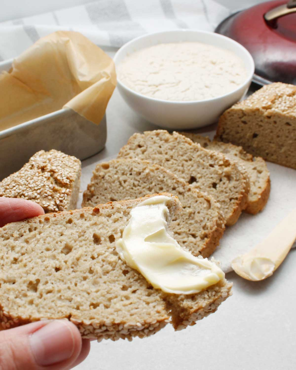 A yummy slice of gluten-free sourdough with butter.