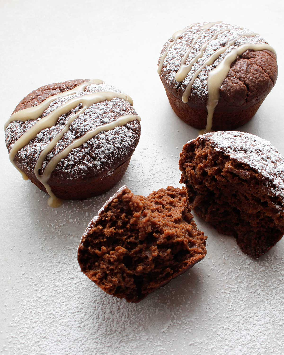 Simply decorated gluten-free chocolate sourdough cupcakes.