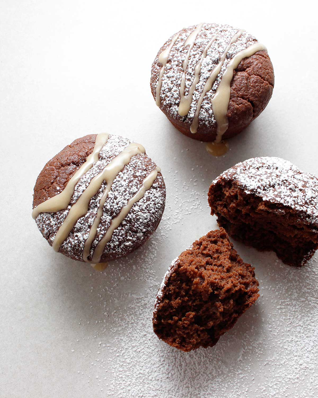 Lightly decorated gluten-free vegan chocolate cupcakes.