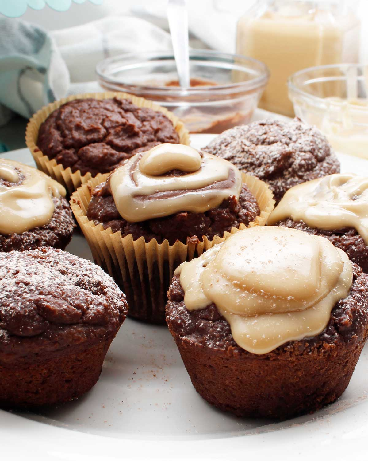 Decorate chocolate cupcakes with powdered sugar, maple cream or chocolate icing.