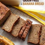 A moist sliced loaf of grain-free banana bread with some allergy-free chocolate on top.