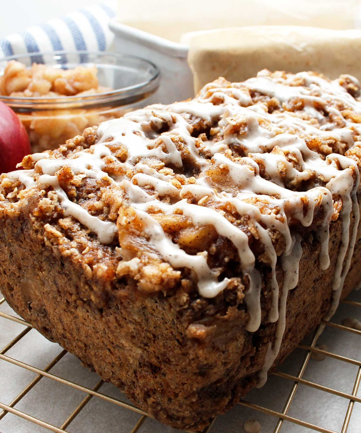 A freshly baked loaf of gluten-free vegan Apple Crisp Bread with a perfect drizzle of sugar and spice.