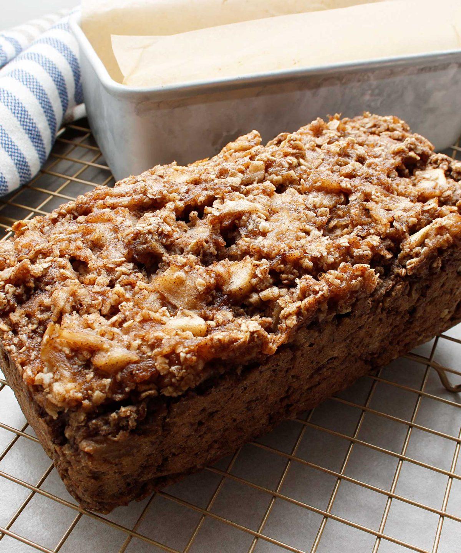 A freshly baked gluten-free vegan apple crisp bread cooling on a wire rack.