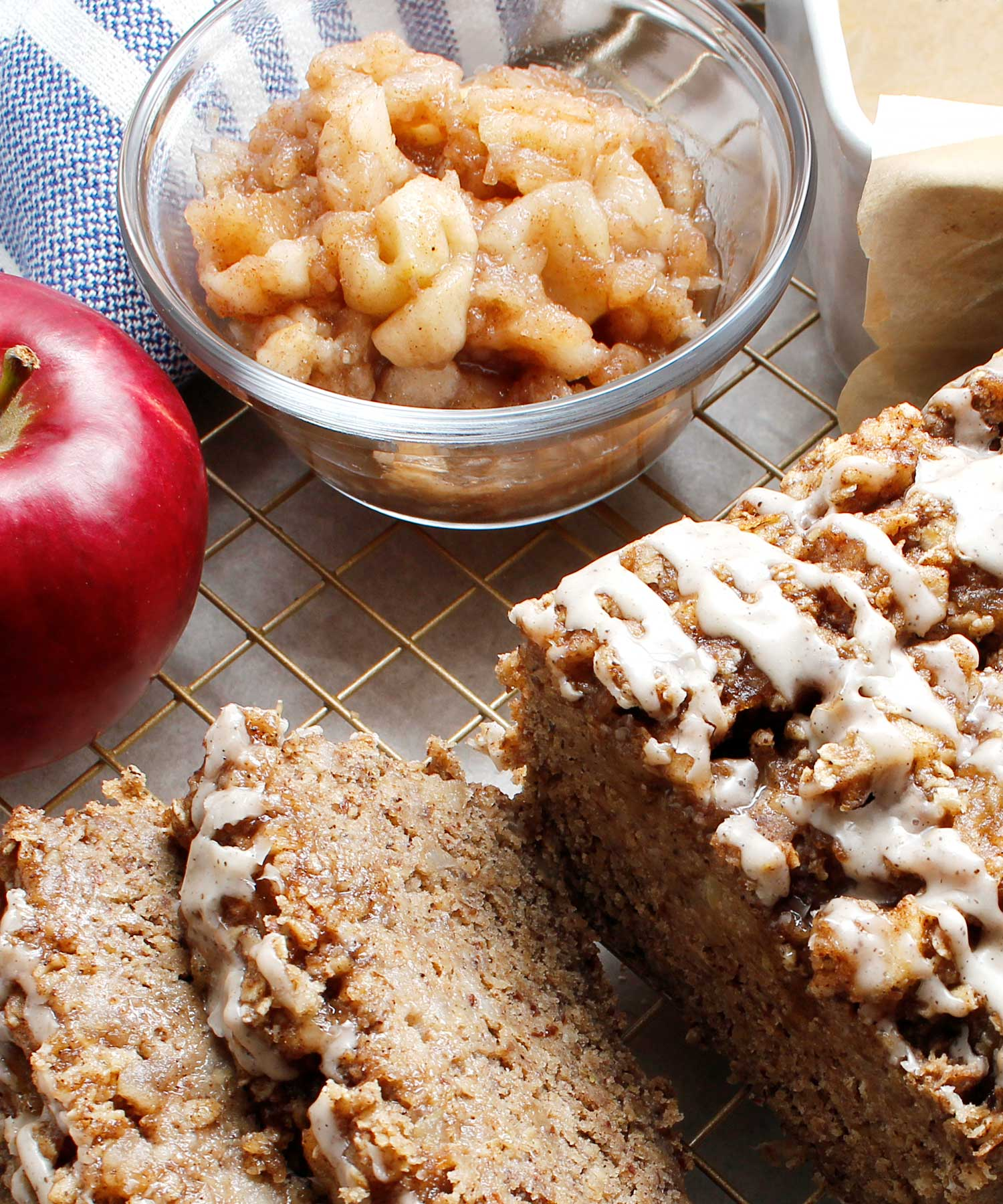 A small bowl of homemade chunky applesauce with a sliced apple crisp bread.
