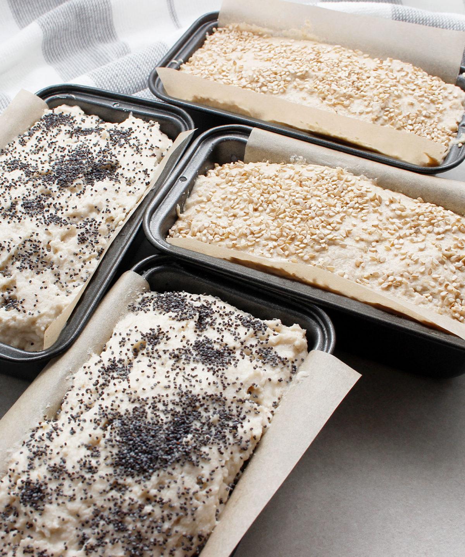 Yeast-free, gluten-free, vegan dough in mini bread pans ready to bake.