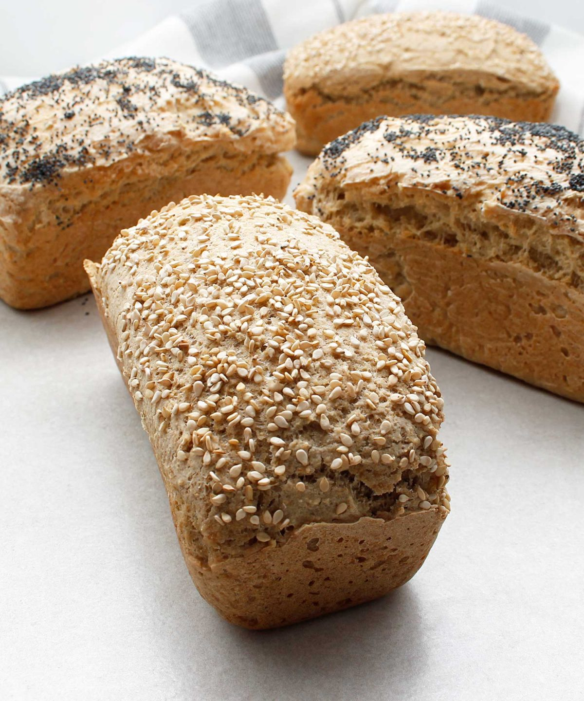 Beautiful mini loaves of yeast-free, gluten-free, vegan bread. Topped with sesame seeds and poppy seeds.
