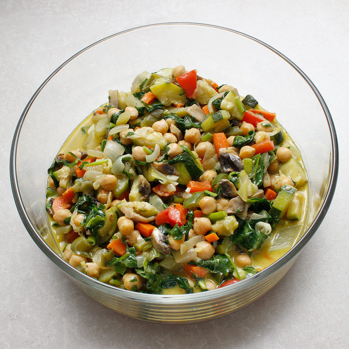 Large glass bowl of vegetable chickpea stew