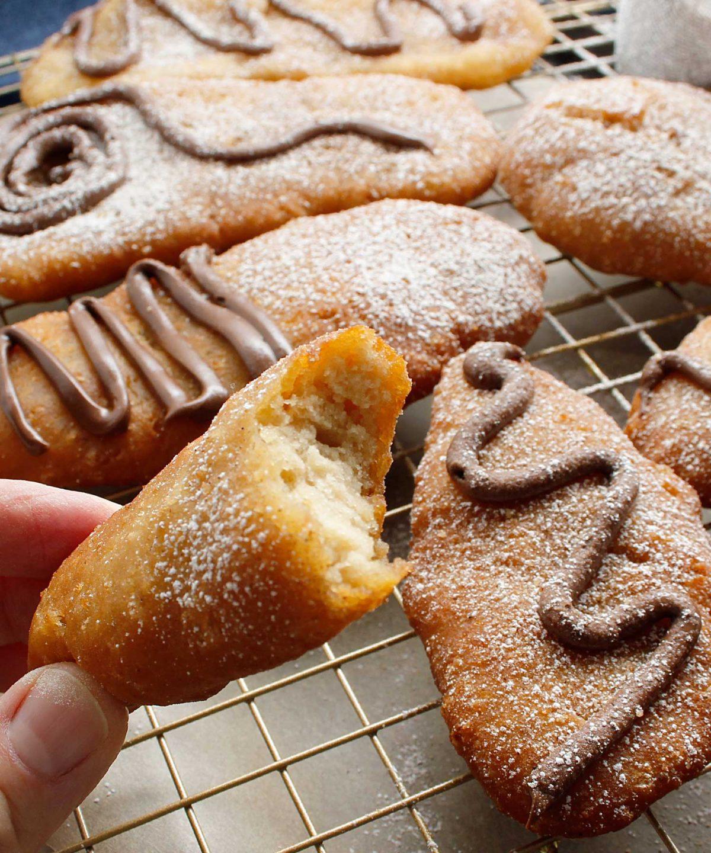 Bite shot of gluten-free vegan Canadian Sourdough Beavertails donuts.