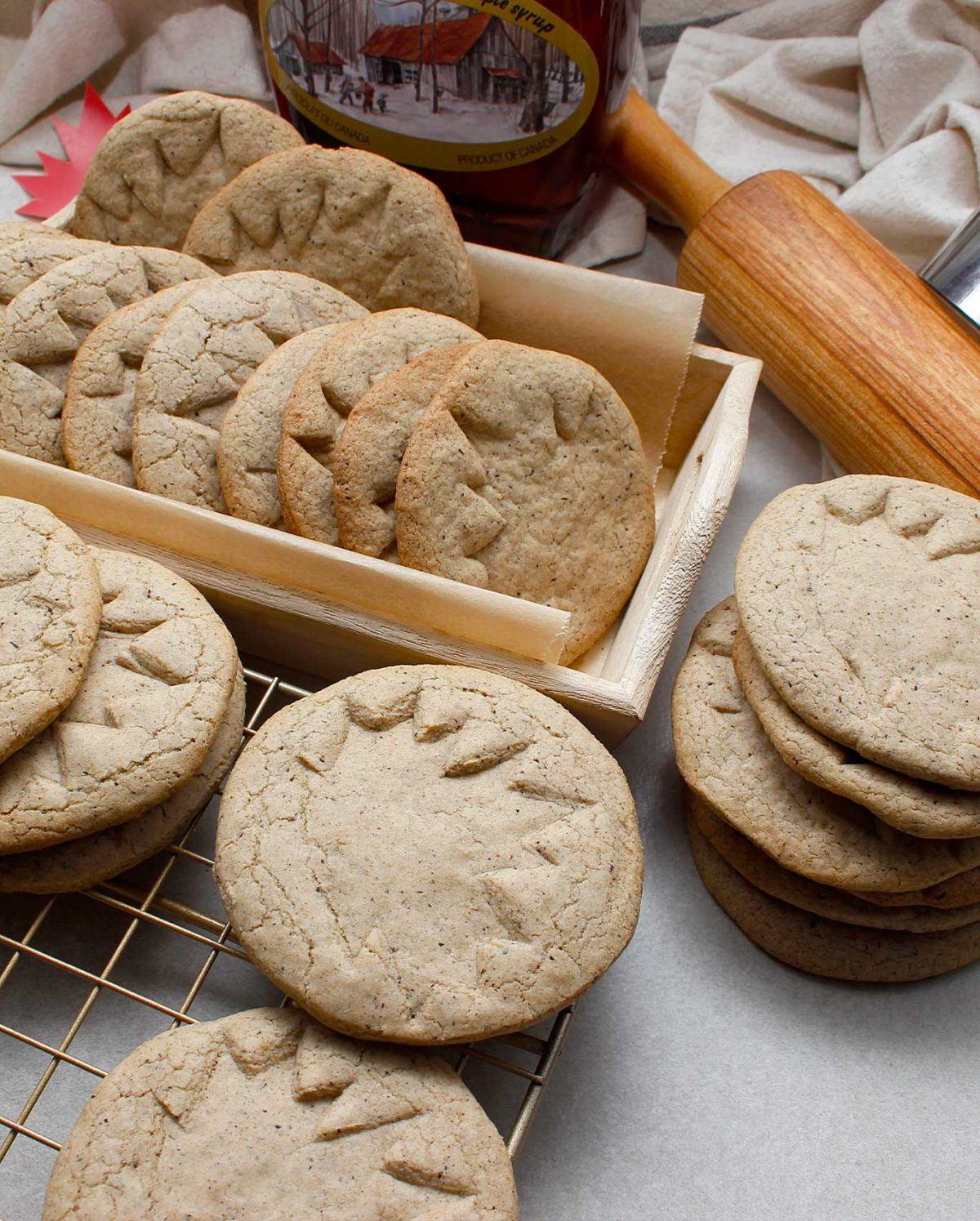 Beautiful round GF Vegan Maple Cookies stamped with a maple leaf